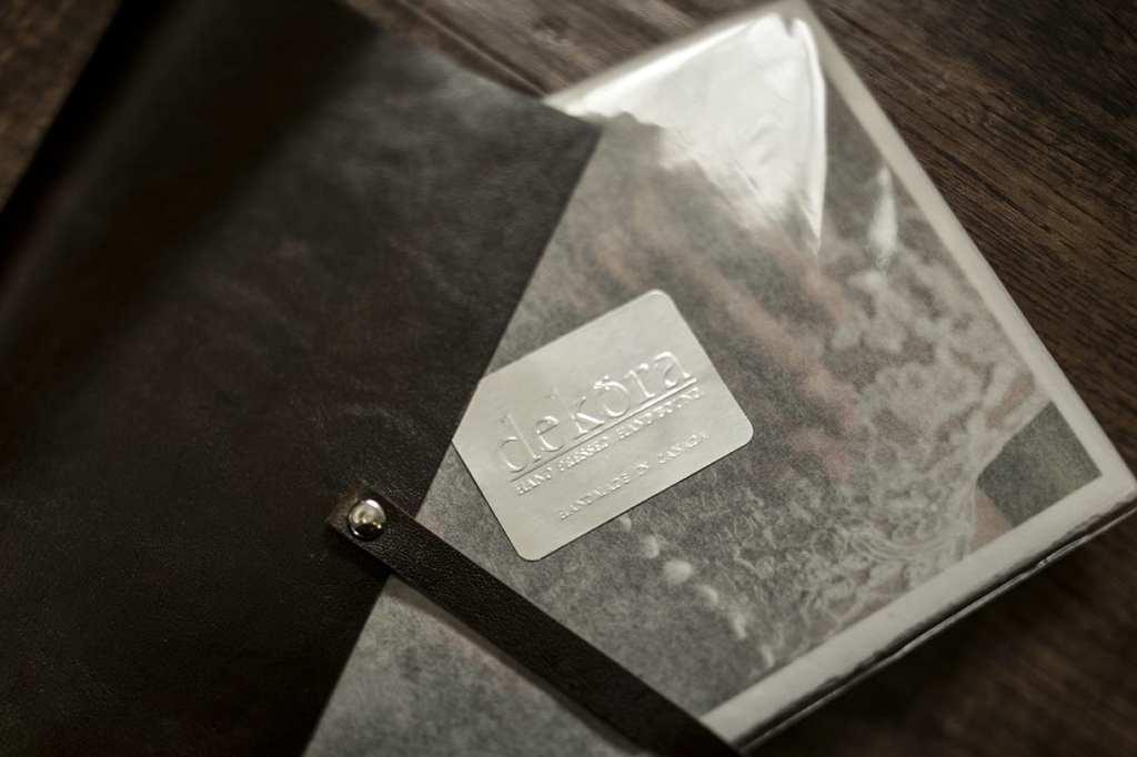 close up of Dekora Album Company packaging of modern Ontario wedding photos and dark leather photo satchel