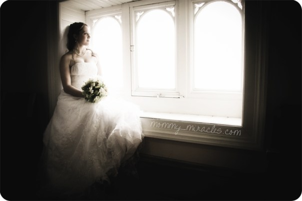 Sitting on a windowsill as a bride