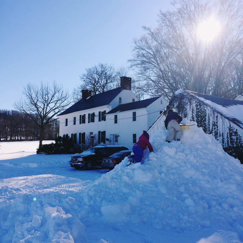 The snow pile, almost to the top of the garage roof.
