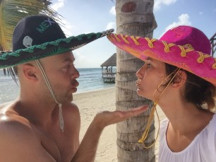 Kissing with a mexican sombrero is not easy!