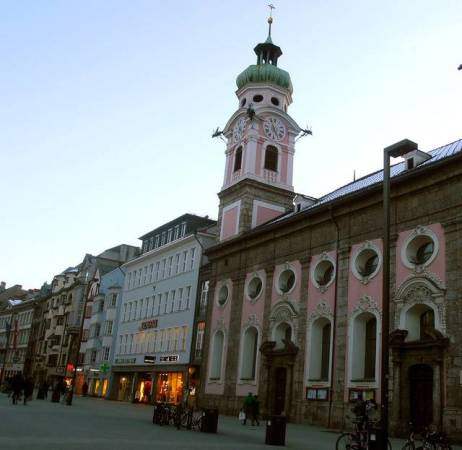 A pink historic church in Innsbruck, Austria is just one of many romantic buildings found in the old town.