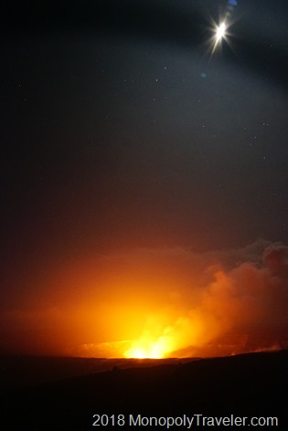 The volcano glowing under the moonlight