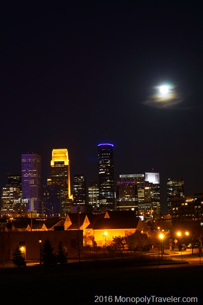 Minneapolis with the moon rising behind it