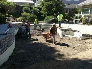 Day laborers work to build a pool