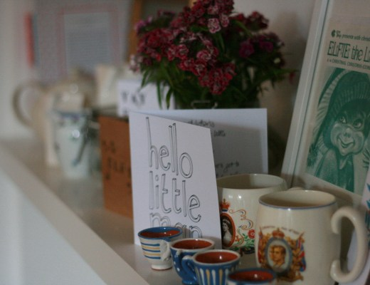Kitchen shelf with cards and flowers