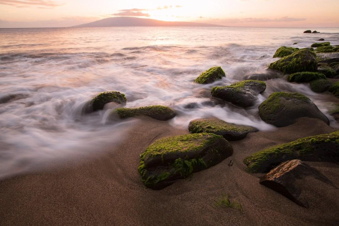 Waves lap at shoreline, Hanakao'o Beach, Maui