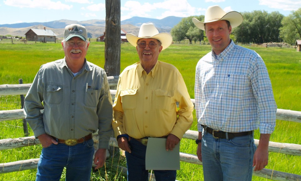 Erik Glenn (far right) with two Colorado ranchers.