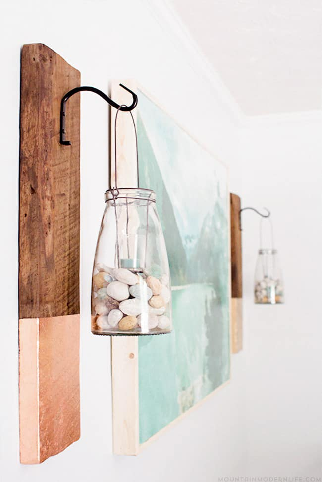 Give old wood new life by reimagining it into a modern rustic wall hanging! This project is super easy and is fun way to display lanterns and plants. MountainModernLife.com