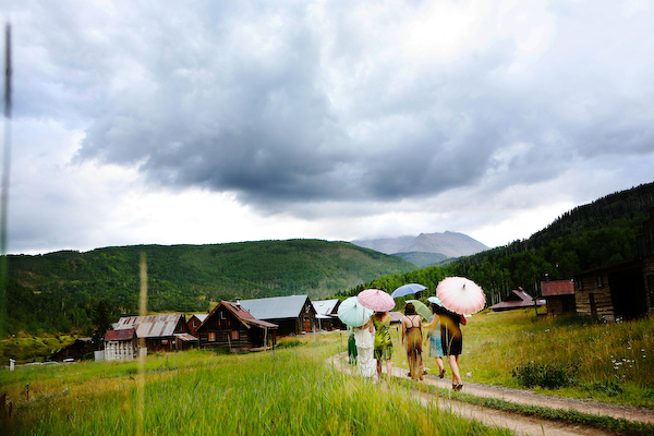 wedding guests walking with umbrellas
