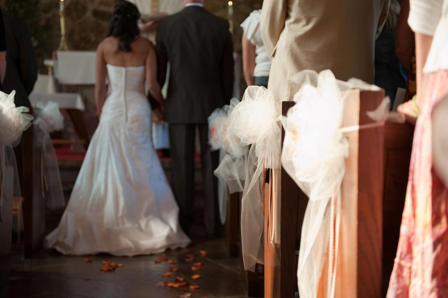 ceremony aisle with orange rose petals