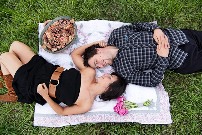 Colorado engaged couple lay on a picnic blanket