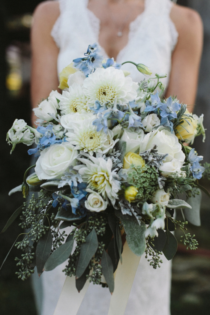 Gorgeous blue and white bouquet with lush greenery. Perfect for a rustic elegant wedding