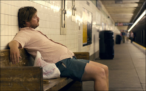 "Tim Heidecker sits in a subway station in a scene from Rick Alverson's ""The Comedy"""