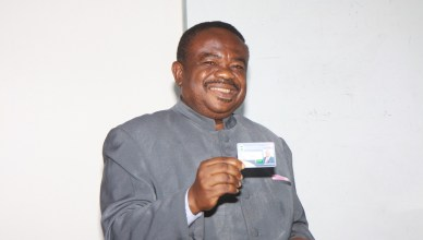 Chairman of COSON, Chief Tony Okoroji displaying his NEIHIS identity card after the official presentation
