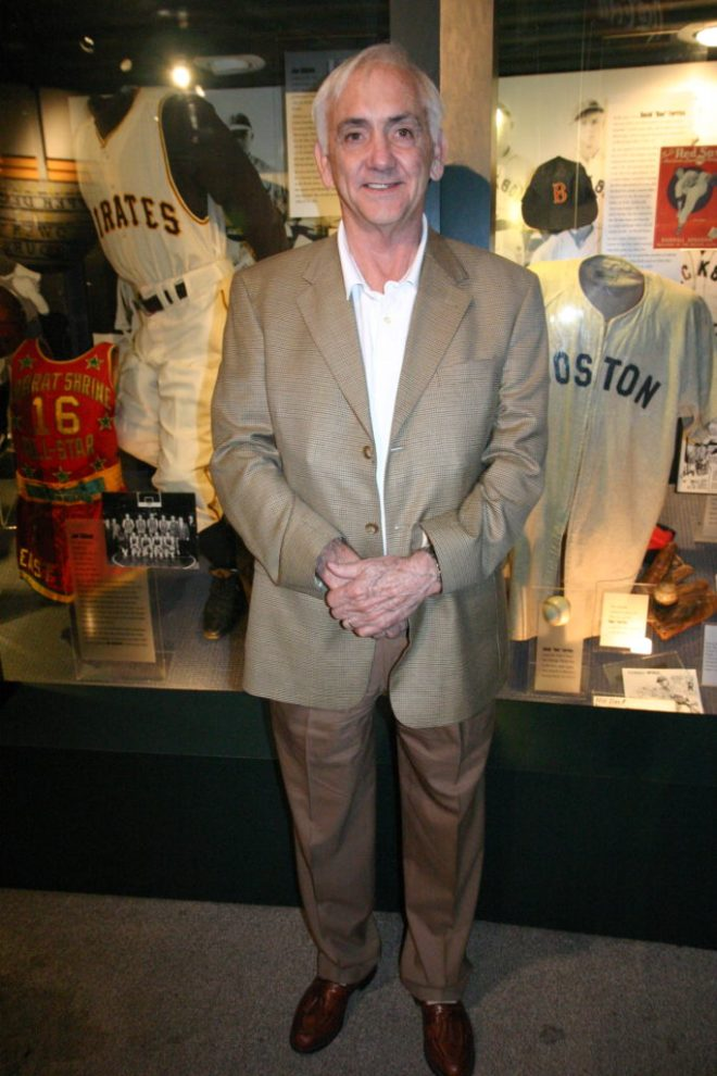 Doug Cunningham, in front of the Hall of Fame's Wall of Memories.