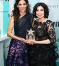 CENTURY CITY, CA - JUNE 16: Actress Sandra Bullock (L) and honoree Sue Kroll, recipient of The Tiffany & Co. / Bruce Paltrow Mentorship Award, pose backstage at the Women In Film 2015 Crystal + Lucy Awards Presented by Max Mara, BMW of North America, and Tiffany & Co. at the Hyatt Regency Century Plaza on June 16, 2015 in Century City, California. (Photo by Mark Davis/Getty Images for Women in Film)