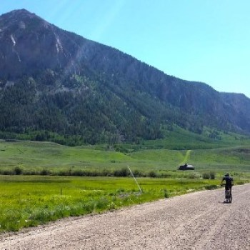 Riding out the dirt road to Tony's Trail under Crested Butte