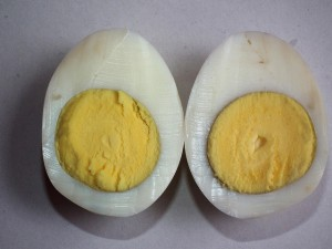 A hard boiled egg showing the white and yolk.