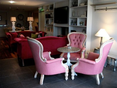 Gt Peter St Hotel, Manchester, UK. We were here discussing beer. Good hotel. Good subject. No hardship. James disapproves of the pink chairs.