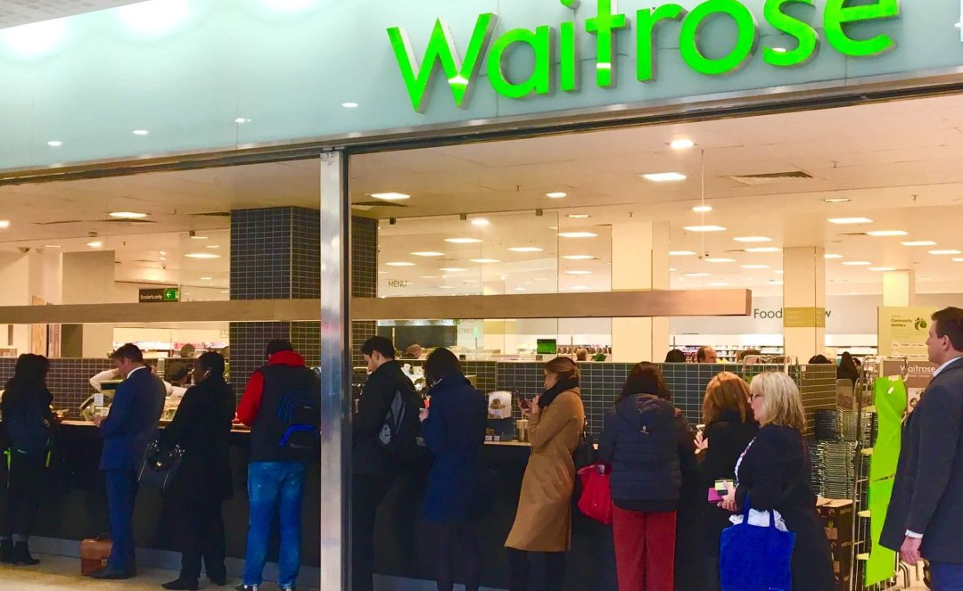 Furious shoppers form an orderly queue for one last freebie.