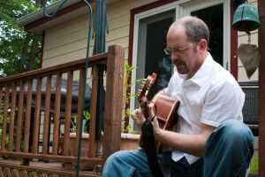 Stan Stewart EPK playing guitar