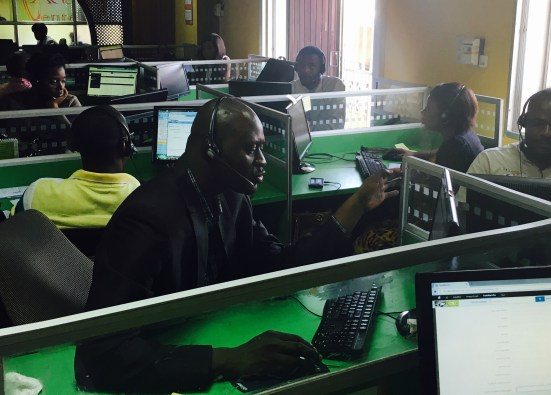 Operators at Congo Call Center in Kinshasa call traders throughout the country.