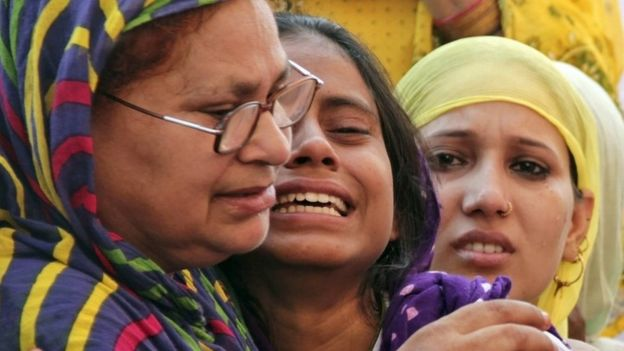 Relatives mourn the death of Mohammad Akhlaq in the village