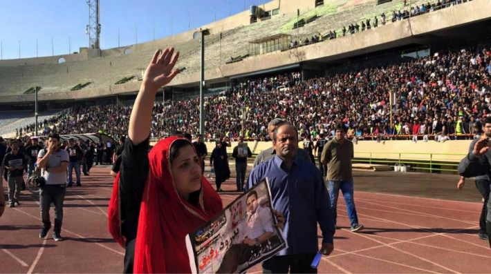 "The wife of the Iranian football player, Hadi Nouroozi, said goodbye to her beloved husband today in the football stadium today. When she entered the stadium she said: ""Finally I came here, I wish I didn't"". Women in Iran are banned from stadium to watch the men's game."