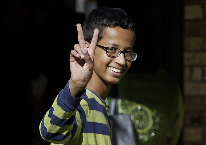 FILE - In this Sept. 17, 2015, file photo, Ahmed Mohamed gestures as he arrives to his family's home in Irving, Texas. The family of the 14-year-old Muslim boy who got in trouble over a homemade clock mistaken for a possible bomb has withdrawn the boy from his suburban Dallas high school Monday, Sept. 21. (AP Photo/LM Otero, File)