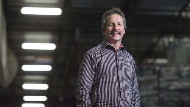 Jim Estill, president and CEO of Danby, poses in the company's warehouse in Guelph, Ont. on Friday, Nov. 27, 2015. Estill is donating up to $1.5 million to support 50 Syrian refugee families in their first year of settlement. THE CANADIAN PRESS/Darren Calabrese