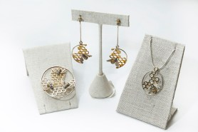 PHOTO: Silver loops with honeycomb interiors support sculpted metal bees on necklace pendants and earrings.
