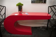 Booth #100, Lee's Antiques: A 1970s Pierre Cardin red formica console table.