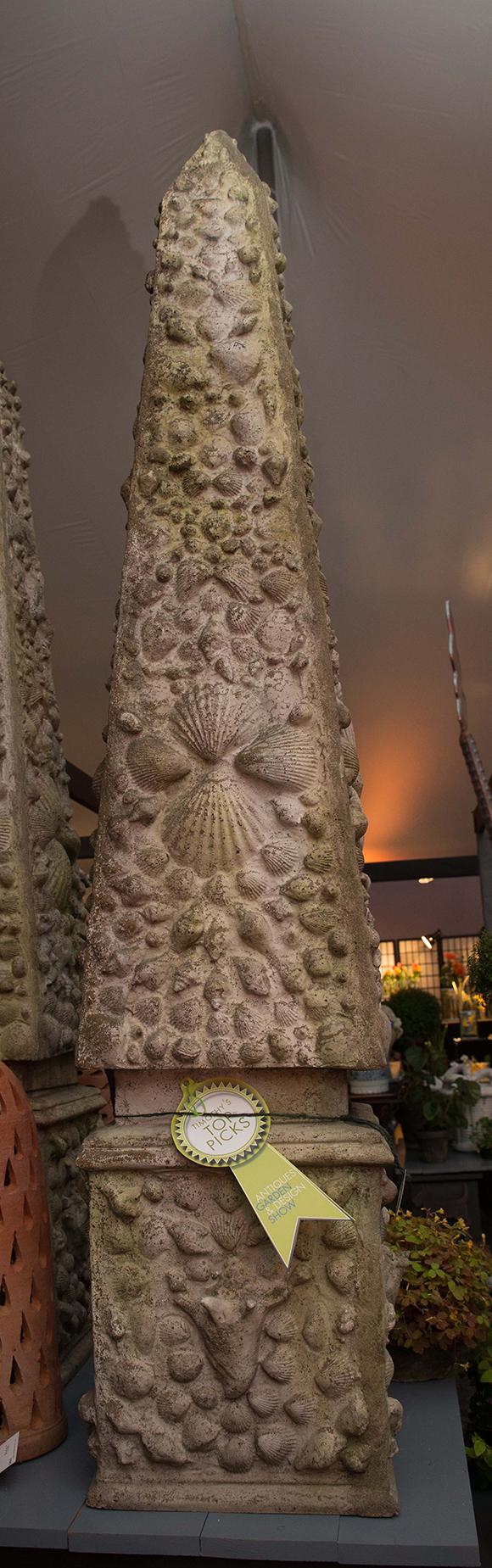 Booth #310, Craig Bergmann Landscape Design: A towering garden obelisk with raised shell motif.
