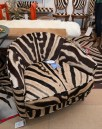 Booth #403, Forsyth: Mario Baughman zebra hide club chairs in warm tones with a chrome frame.