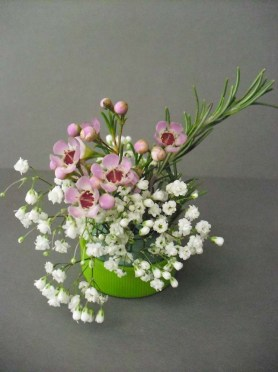 PHOTO: a tiny bouquet of waxflower, baby's breath, and rosemary.