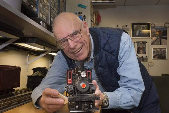 PHOTO: Dave Rodelius shows off one of the stars of the Model Railroad Garden this summer: a steam engine!