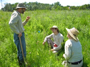 Wagenius and students discuss the discovery of a fly larva found eating pollen on a plant.