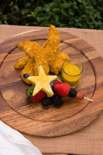 PHOTO: Cornflake-crusted chicken tenders with a skewer of fresh fruit.