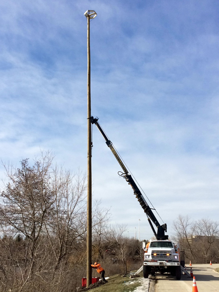 PHOTO: Installing and osprey nesting pole.