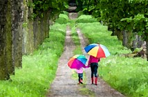 52504746 - mother and her daughter with umbrellas in spring alley