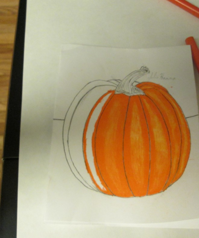 Continuing to color in the orange portion of the pumpkin.