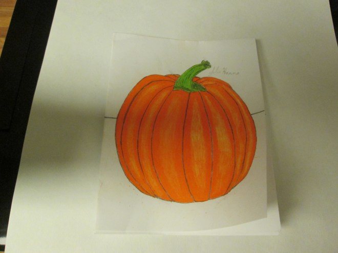 Here I colored in the stem of the pumpkin with a green colored pencil.
