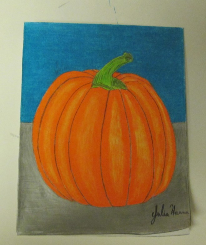 The completed pumpkin drawing.  The pumpkin is sitting on a sliver table with the blue sky in the background.