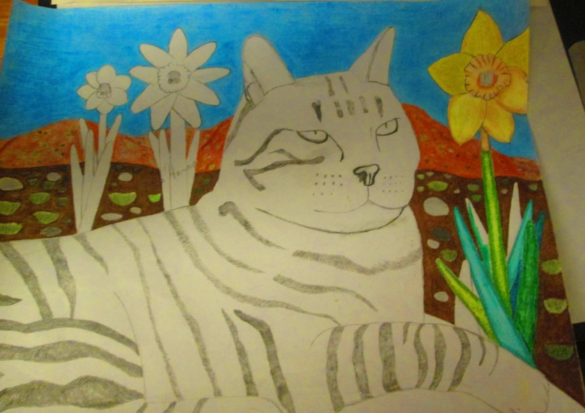 I used brown colored pencils the shade in the mountains behind Stripey cat. Also, the daffodils were colored in with yellow and green colored pencils.