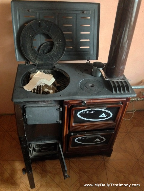 Stove provides heat for the room and a place to cook