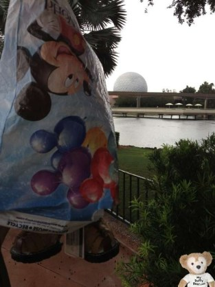Duffy the Disney Bear poses with Spaceship Earth, EPCOT