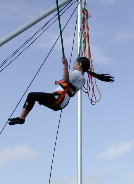 A girl enjoys the Power Jump ride at the 2012 waterfront festival.