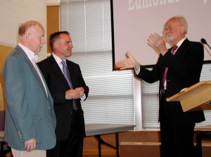 Mayor Earling starts audience applause for Terry Vehrs and John McGibbon Tuesday night.