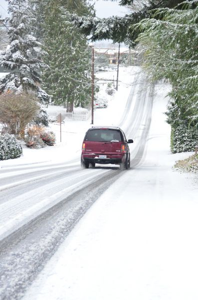 The 8:30 am scene on 200th Street Southwest just west of Maplewood School shows a passable but slippery road surface.