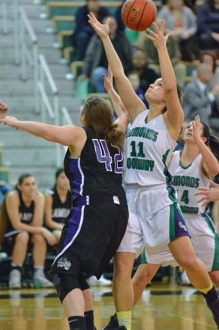 Eck pulls down a rebound as Kamiak's Katy Hamill watches.